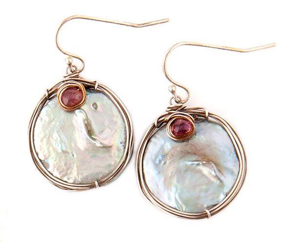 jewelry photography with pure white background photograph of large round opal and wire dangle earings.