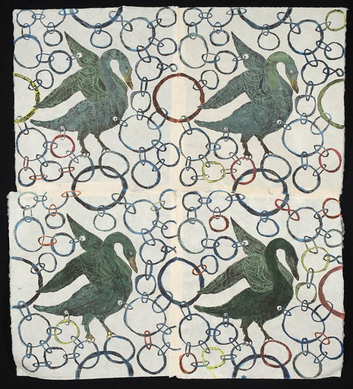 photograph of thin paper artwork mounted on black showing four green ducks and colored linked circles