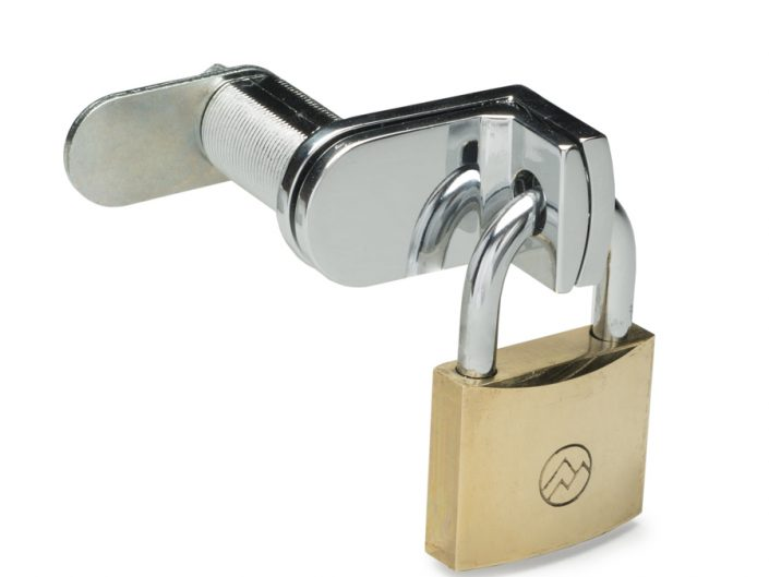 Product photograph of small brass lock locked to L shaped chrome latch a pure white background