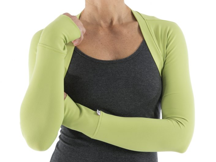 product photography of live model bust wearing elastic gray top with green arms on pure white background